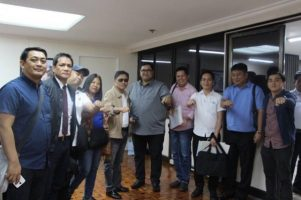 """PRRC doing President Duterte's """"fist bump"""" hand gesture.."""