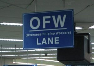 OFW (Overseas Filipino Workers) Lane signage on airport.