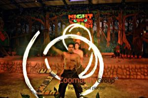 Three men fire dancing on Zoobic Night Safari.
