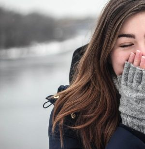 woman in winter clothes closed eyes