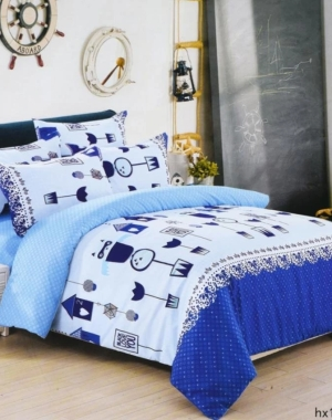 Bed with blue bed sheets
